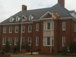 Flags at a State House building.