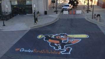 The Oriole Bird is painted in the street at The Avenue in White Marsh ahead of a rally scheduled there for 1 p.m. Tuesday.