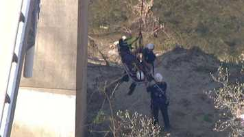 The worker and a crew member were then lifted up on the ropes using a crane to the top of the bridge.