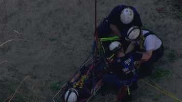 Sky Team 11 video showed crew members securing the person in a rescue basket and ropes.