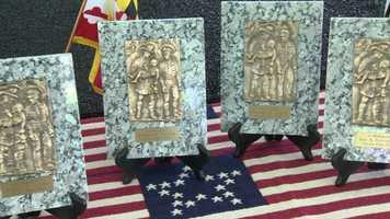 Each wreath is in memoriam of the fallen eight officers.