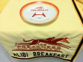 It started with a cup of coffee. In the late 1930's on the porch of the historic Pimlico Clubhouse, a group of trainers, owners and greater and lesser dignitaries would gather in the mornings to tout the merits of their horses. Today's Alibi Breakfast is a descendant of the original gathering at the Old Clubhouse, featuring media, owners, trainers, jockeys and horsemen celebrating Preakness. The annual media and awards breakfast has also become an opportunity for the Maryland Jockey Club to recognize those who have made significant contributions to the racing industry and to solicit intriguing race predictions from the connections.