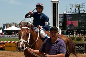 Mary Russ-Tortora's back in the winner's circle after aHaywired overcame an awkward start and held off a pair of late closers to win the $52,000 Lady Legends for the Cure IV presented by Wells Fargo at Pimlico Race Course.