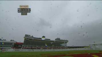 It begins to rain lightly at Pimlico about three hours before the race.