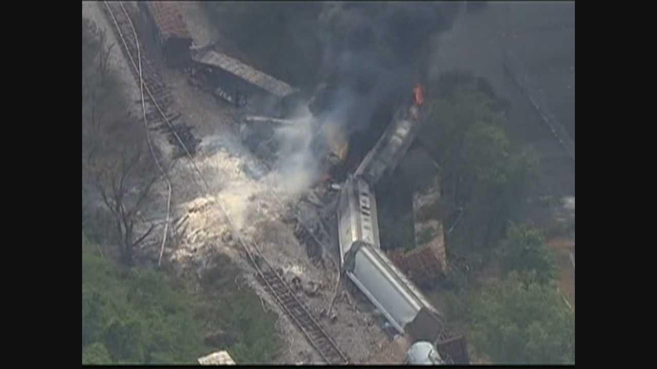 Surveillance video shows train, truck collision