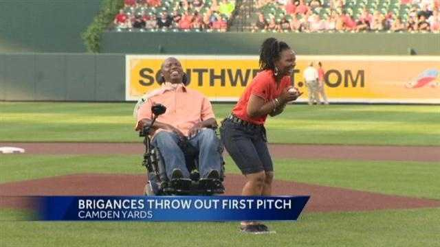 Former Raven O.J. Brigance and his wife throw out the first pitch at the Orioles-Nationals game in support of ALS Awareness Month.