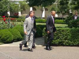 Baltimore Ravens General Manager Ozzie Newsome and Baltimore Ravens Head Coach John Harbaugh join President Barack Obama at the White House.