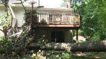 In Columbia, a tree fell onto a home on Weatherside Run around 1:30 a.m., collapsing part of the roof, damaging a wall and taking out the home's deck.