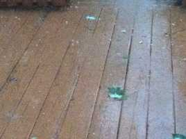Pea-sized hail on a deck in Eldersburg.