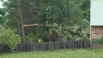 His neighbors described debris flying through the air and what appeared to be a funnel cloud.