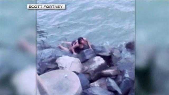 New cellphone video shows the survivor of a crash on the Chesapeake Bay Bridge swimming to safety moments after her car plunged off the bridge Friday night.