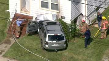 Both the vehicle and the house had caught fire, but officials say fire crews were able to put out the flames quickly.