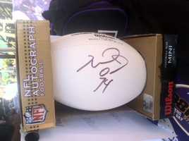 A Michael Oher-autographed football is up for grabs, too.
