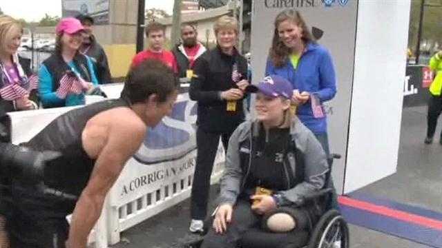 Berdan meets fellow teacher and Boston Marathon bombing survivor Erika Brannock, who got to hold the finish line tape for him.