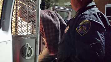 A suspect is arrested during the raids.