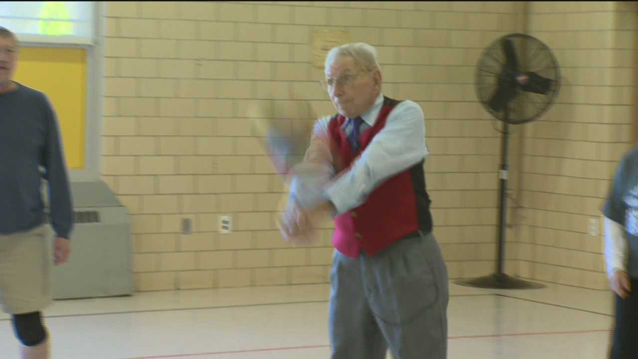 Man honored for starting volleyball league