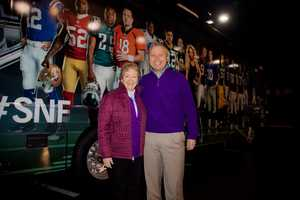 WBAL-TV General Manager Dan Joerres and executive assistant Sharon Mcnicholas pose for a shot before checking out the SNF bus.