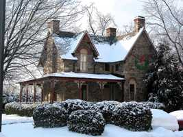 The snowy Greenway Cottage at Roland Park Place in Baltimore.