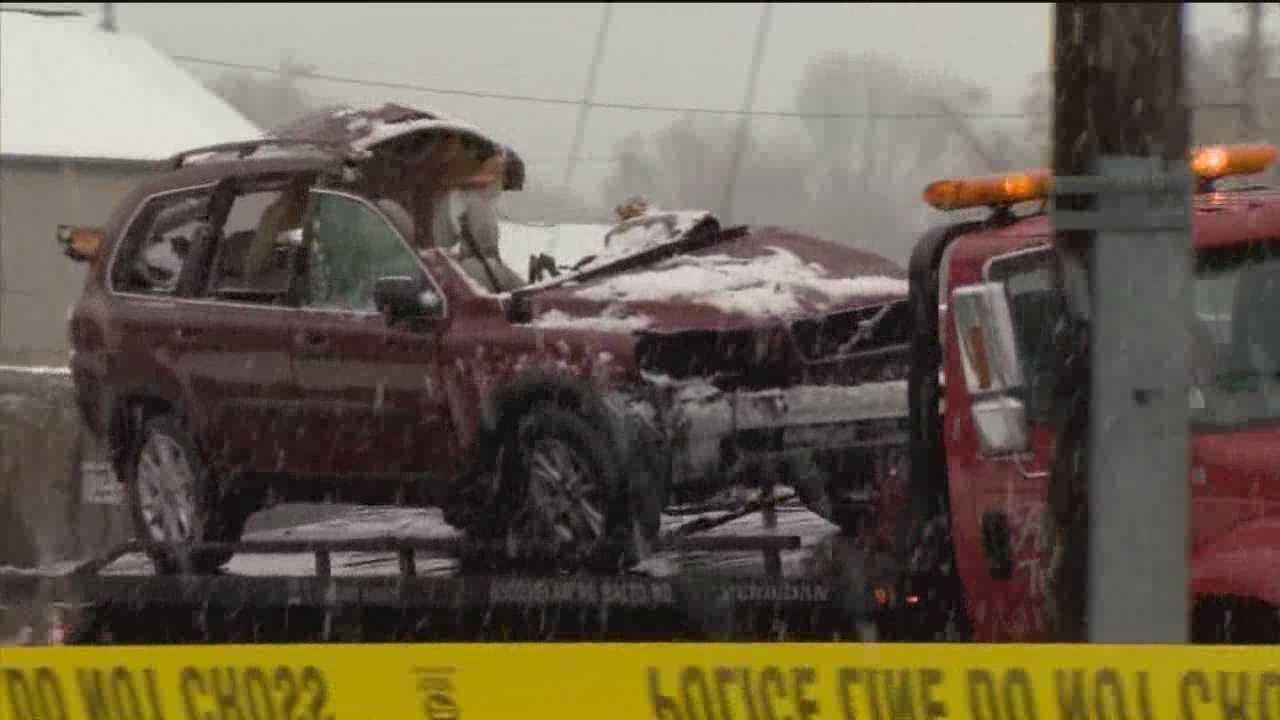 2 killed when train, SUV collide