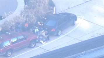 Sky Team 11 images show a massive police presence surrounding the courthouse to investigate the incident.