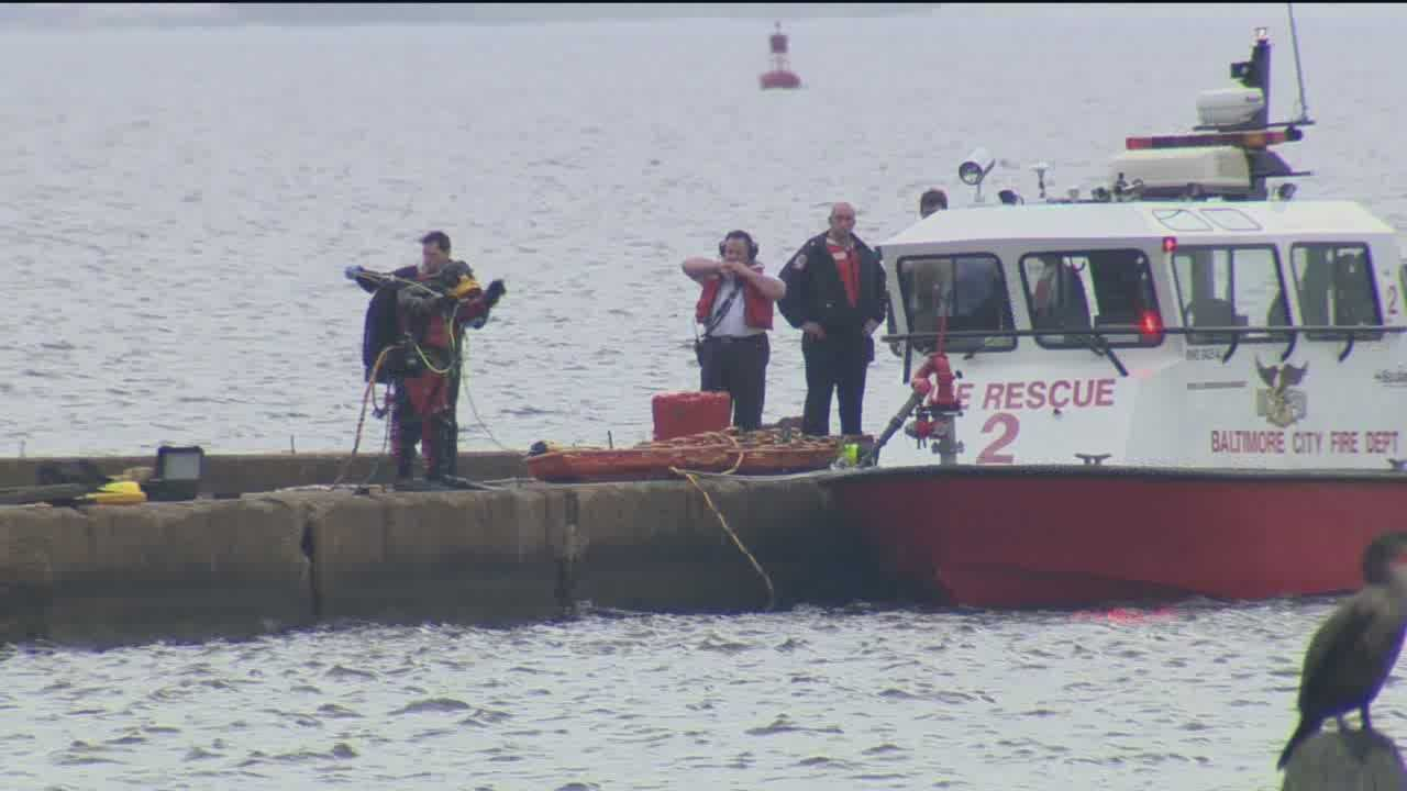Investigators said they got a 911 call about two men and a woman being in the water around 6 a.m. in the Port Covington area of south Baltimore.