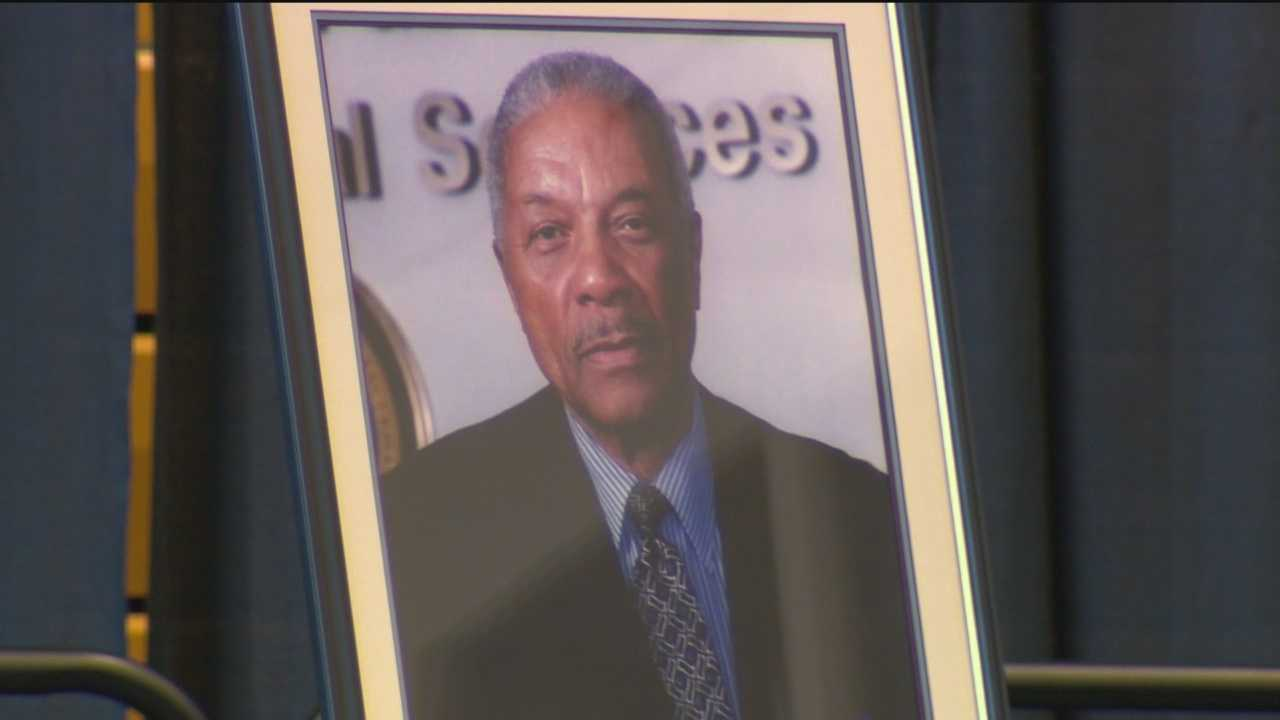 Mourners celebrate man who tore down barriers