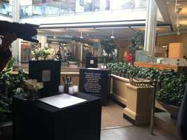 Jan 27: A memorial to the victims of Saturday's shooting is set up inside the Columbia Mall as it prepares to reopen.
