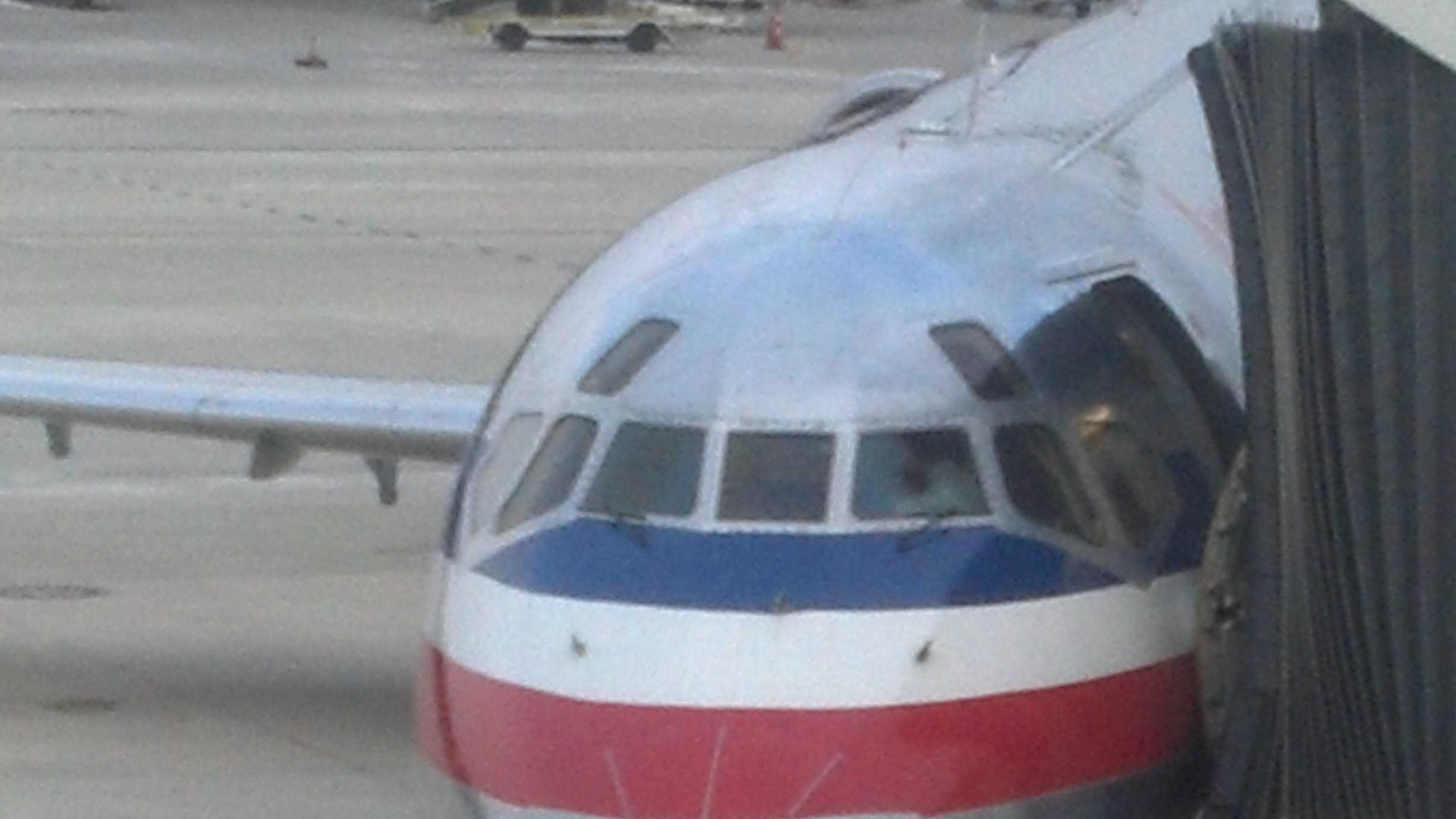 Tow vehicle strikes plane at BWI