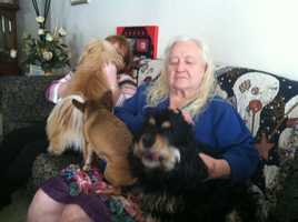 Mary Root with her daughter and her dogs.