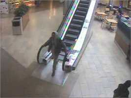 Suspect down escalator