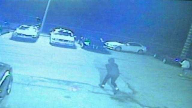 Video shows two men running out on the parking lot getting into two cars.