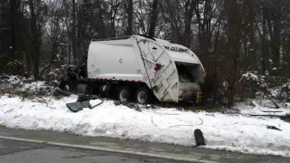 Garbage truck involved in multivehicle crash