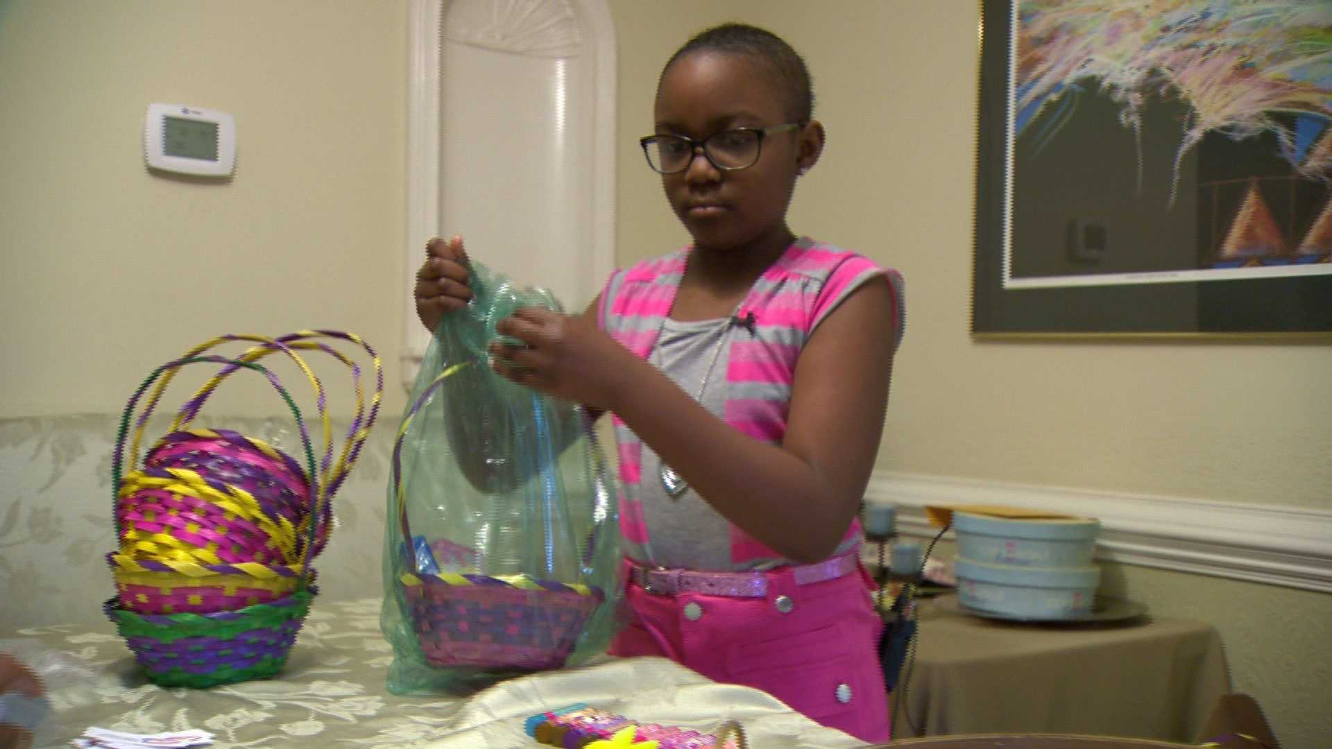 Grace Callwood, 9, packs Easter baskets for kids in need.