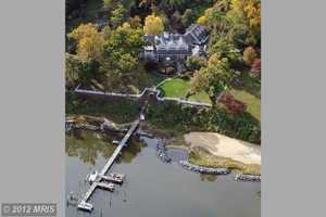 Spend $5.950 million for this Annapolis home at 1810 Lindamoor Lane and gain a magnificent three-acre waterfront estate with 250 feet on the Severn River and panoramic water views.