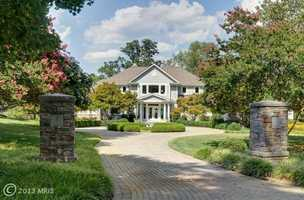 This custom Annapolis home sits on two private acres with 400 plus frontage on Weems Creek just off Severn River.