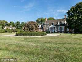 The home has four bedrooms, five full baths and two half baths.