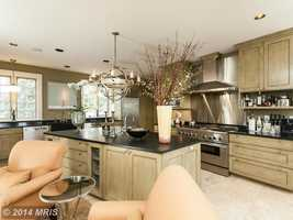 Patrick Sutton/Trish Houck designed the kitchen with a fireplace.