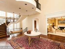 The home has grand formal living spaces with exquisite design elements and custom finishes.