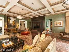 The home also features six bedrooms, seven full baths, three half baths, grand formal living spaces with exquisite design elements and custom finishes.