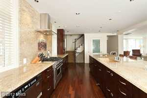 The kitchen also features a breakfast bar and island.