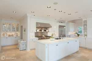 The kitchen is gourmet with a breakfast room, an island and family room off to its side.