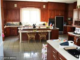 The gourmet kitchen features an island, breakfast room and butler's pantry.