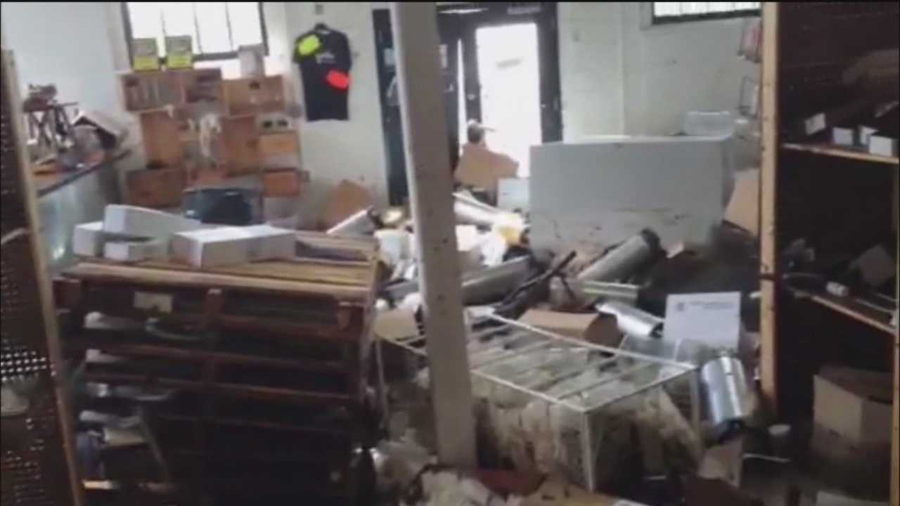 Businesses flooded by rain struggle to reopen