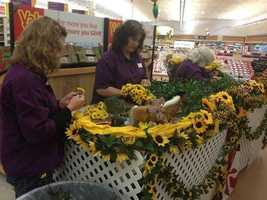 May 15: Workers at the Giant Food in Towson work to create the flower blanket for the Preakness Stakes.