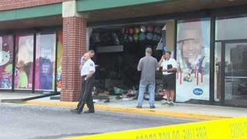 Crews spend hours Thursday cleaning up a mess at an Annapolis store after police said a car careened into it.