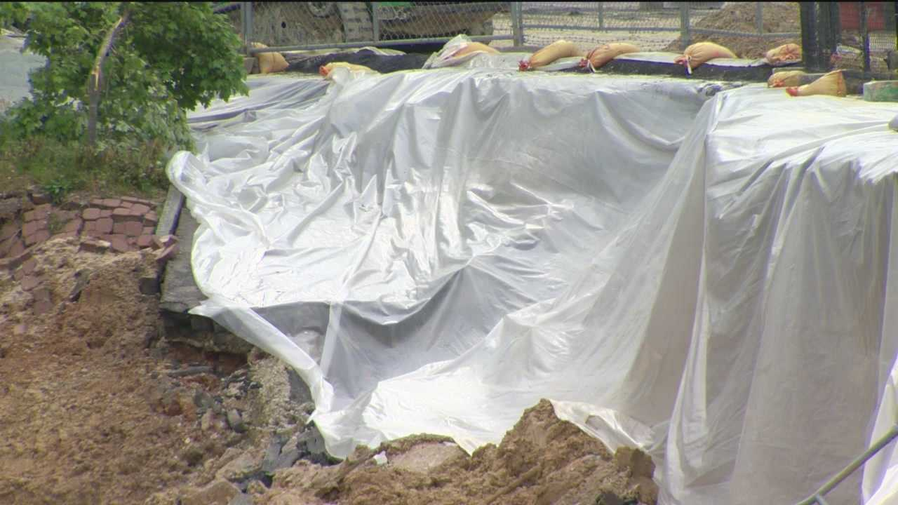 Work crews at the site of the 26th Street collapse took steps to divert water away from the collapsed slope and covered it with plastic sheeting to prevent erosion in preparation of heavy rains. By Friday afternoon, it was clear that the precautionary efforts had paid off.