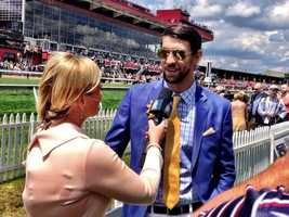 May 17: Michael Phelps at Preakness speaking with NBC'sCarolyn Manno.