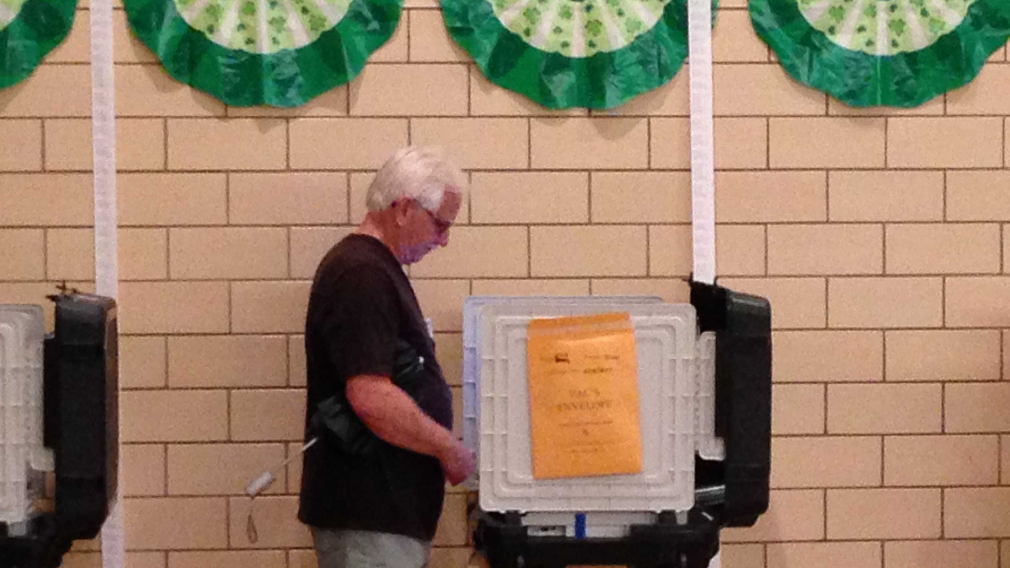 Several voters lined up to cast their ballots early Thursday.