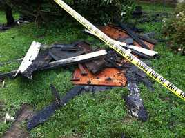 Charred wood and shingles from the steeple that was destroyed by fire after being struck by lightning early Thursday morning at Monkton United Methodist Church