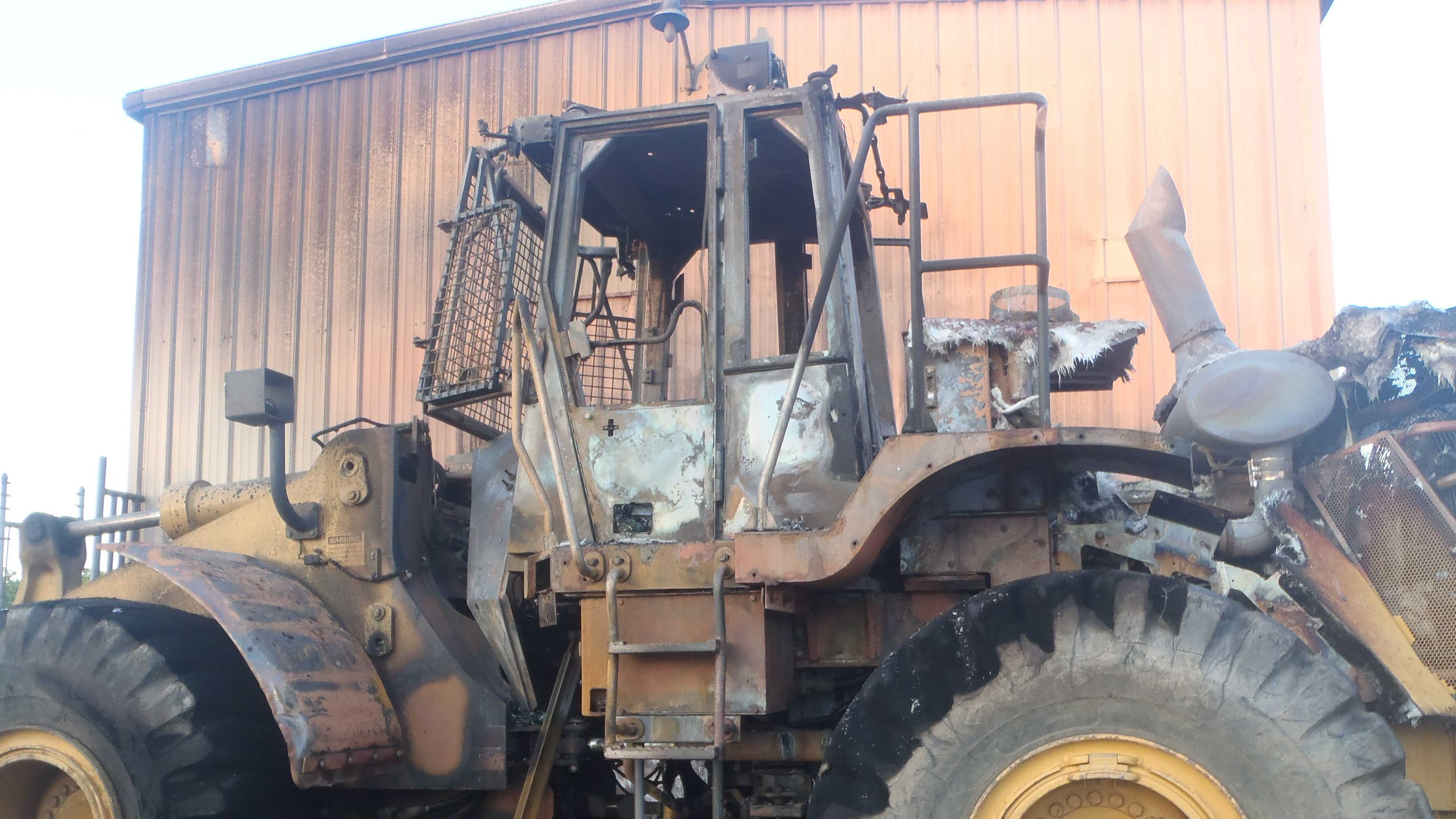The front-end loader was destroyed in the fire.